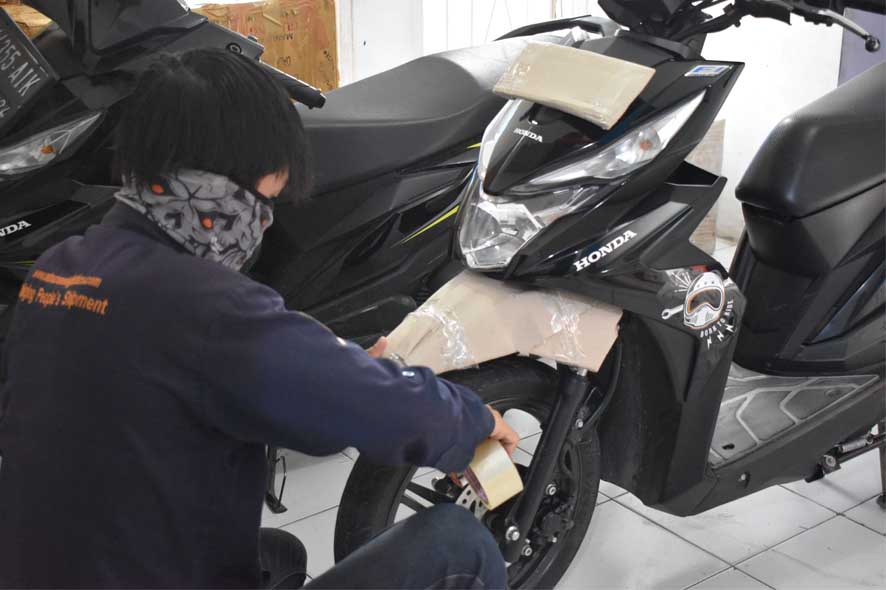 pengiriman sepeda motor